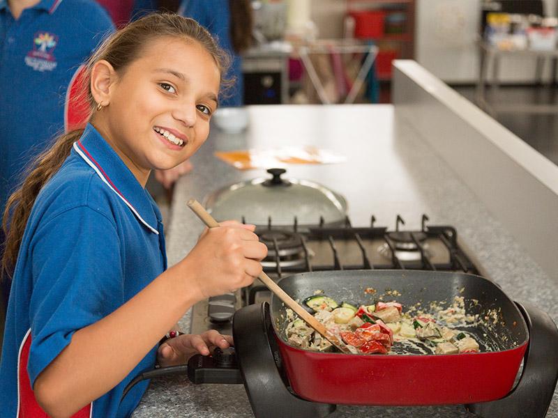 Student participating in the Stephanie Alexander Kitchen Garden program at Beckenham Primary School